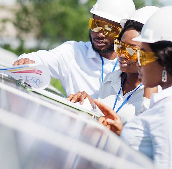 African American technician near solar panels