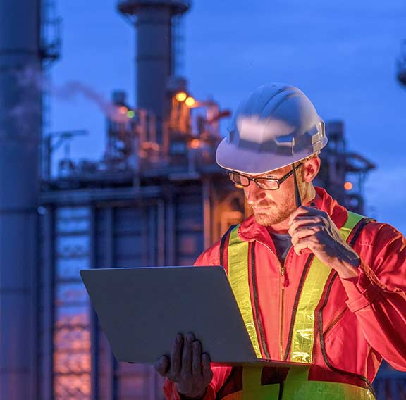 Engineer at oil refinery building in heavy petrochemical industry