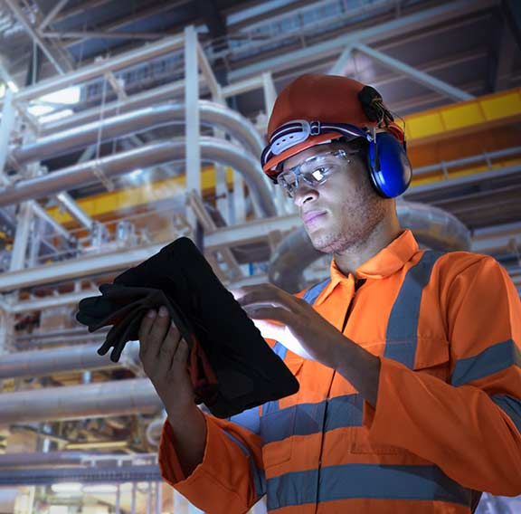 Engineer in nuclear power station using digital tablet